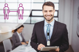 Portrait_of_confident_young_businessman_using_digital_tablet_while_colleague_in_background