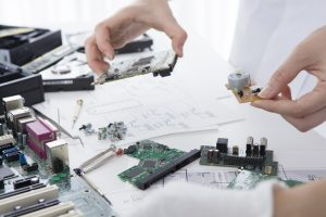 Two_women_to_study_the_circuit_board
