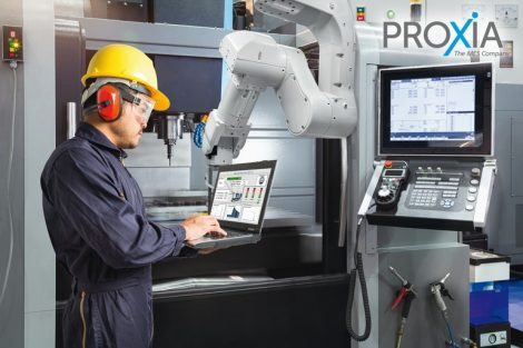 Maintenance_engineer_using_laptop_computer_control_automatic_robotic_hand_with_CNC_machine_in_smart_factory._Industry_4.0_concept